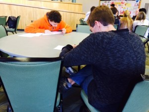A few minutes into the annual WriteOff competition, Peter Warren, left, of Scotch Plains-Fanwood High School, and Bryan Gallion of West Essex High School, get down to the writing. They were two of 15 contestants for the grand prize – a $100 award from The Bergen Record, sponsors of the competition.